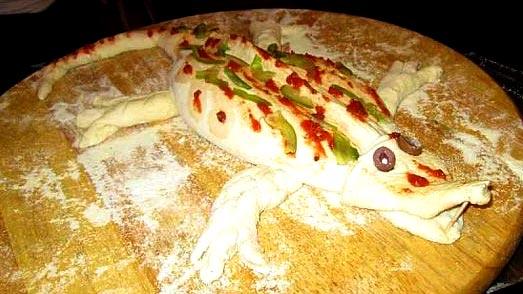 Crocodile-shaped pizza calzone
