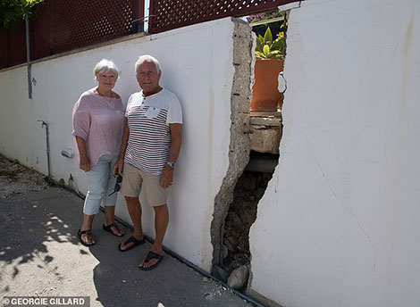 Anne Everett and Don Everett's garden and house twisting due to the landslide